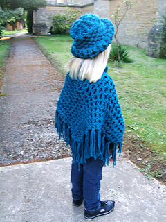 Poncho_and_hat_by_church_path_back_shot_small2