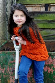 Ela_orange_sweater_garden_fork_small2