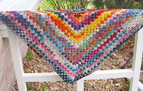 Leftover_sock_yarn_shawl_on_porch_rail_bright_medium