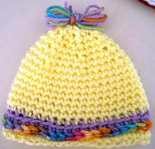 Gift_hat_for_little_ones_yellow_on_counter_small2