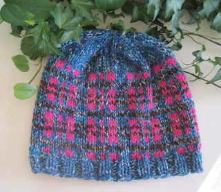 Tweedy_plaid_beanie_turq_br_pink_flat_on_plant_small2